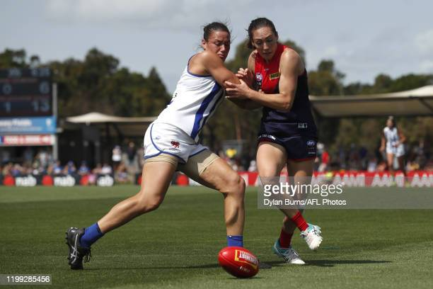Kate Gillespie-Jones of the Kangaroos and Meg Downie of the Demons compete for the ball during the 2020 AFLW Round 01 match between the Melbourne...