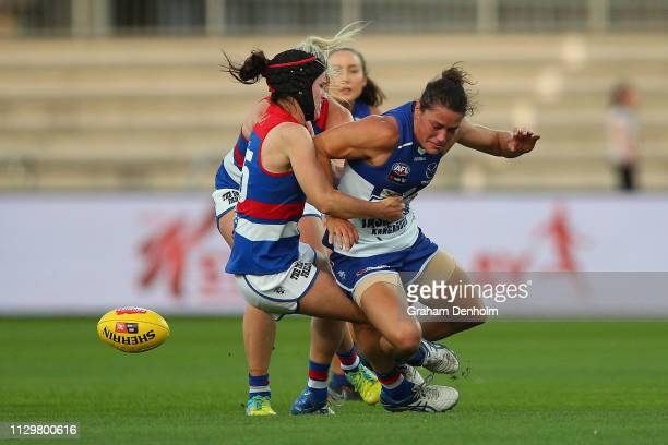Kate GillespieJones of the Kangaroos is tackled during the round three AFLW match between the North Melbourne Kangaroos and the Western Bulldogs at...