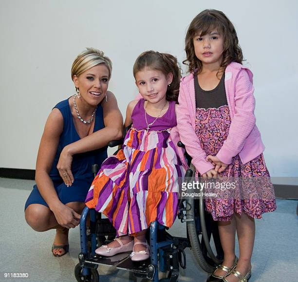 Kate Gosselin of John and Kate Plus 8 reality TV on TLC poses for a photograph with Hennessy Hernandez 6 center and sister Alannah Hernandez 5 both...