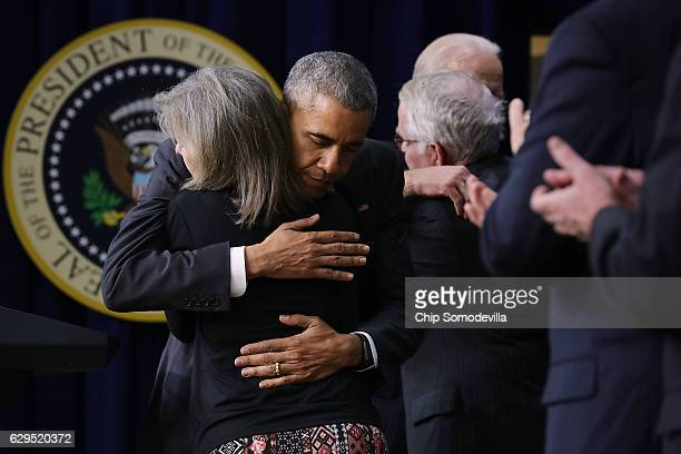 Kate Grubb, who lost her daughter Jessie Grubb earlier this year after a long battle with substance abuse, embraces U.S. President Barack Obama...