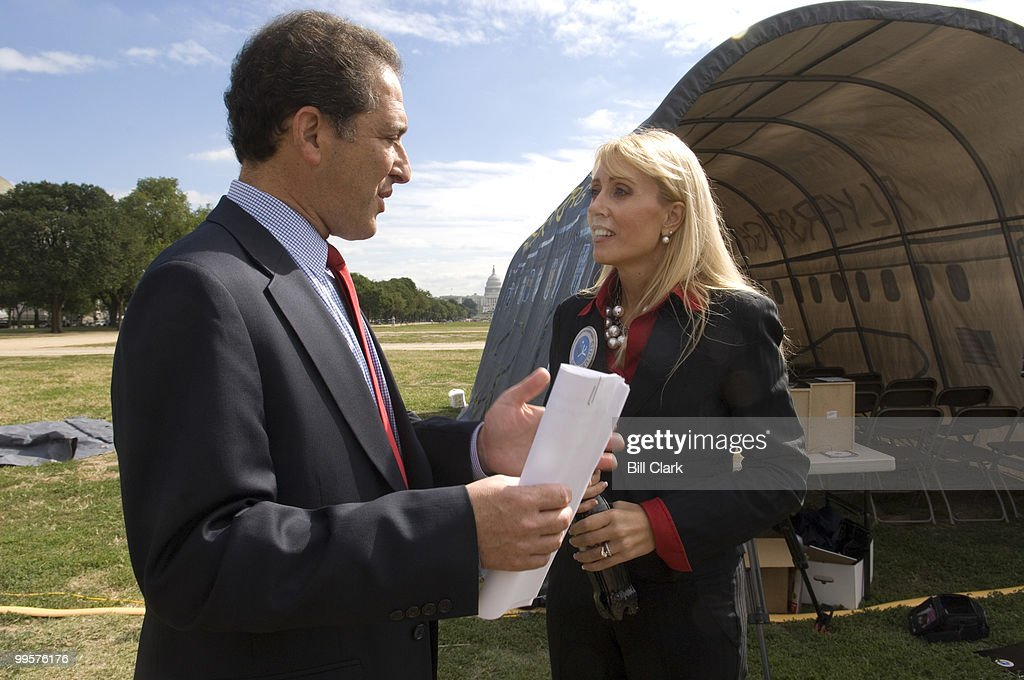 Kate Hanni, founder and executive director of of CAPBOR (The Coalition for an Airline Passengers' Bill of Rights) speaks with Rep. Ron Klein, D-Fla., as she shows off the mock airline cabin erted on the National Mall for a news conference to draw attention to passenger's rights legislation on Wednesday, Sept. 19, 2007.