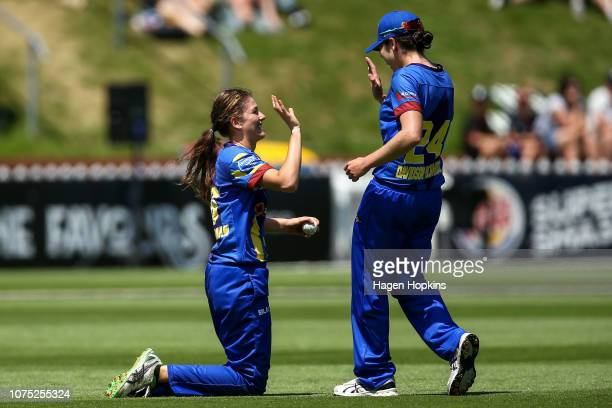 Kate Heffernan of Otago celebrates with Alice DavidsonRichards after taking a catch to dismiss Amelia Kerr of Wellington during the T20 match between...