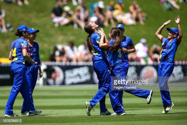 Kate Heffernan of Otago celebrates with Emma Black after taking a catch to dismiss Amelia Kerr of Wellington during the T20 match between the...