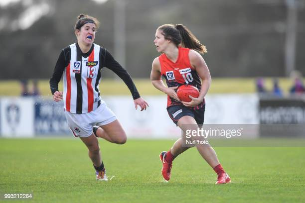 Kate Hore of the Casey Demons handballs the ball during the VFL Women's round 9 game between the Casey Demons and Southern Saints at Casey Fields in...