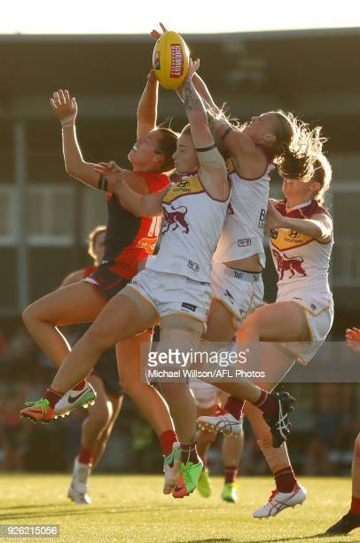Kate Hore of the Demons and Nicole Hildebrand of the Lions compete for the ball during the 2018 AFLW Round 05 match between the Melbourne Demons and...