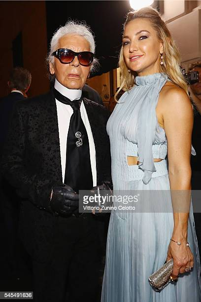 Kate Hudson and Karl Lagerfeld attend the Fendi Roma 90 Years Anniversary fashion show at Fontana di Trevi on July 7 2016 in Rome Italy