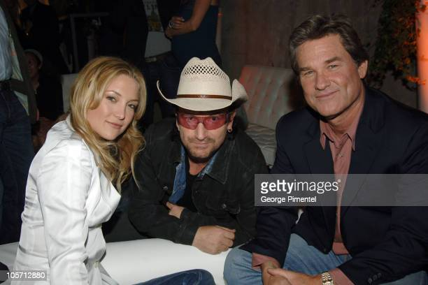 Kate Hudson Bono of U2 and Kurt Russell during 2005 Toronto Film Festival 'One x One' Dinner in Toronto Canada