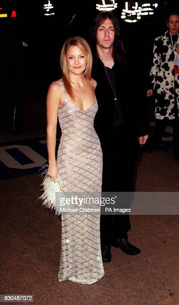 Kate Hudson daughter of Goldie Hawn with Rock star boyfriend Chris Robinson from the group 'The Black Crowes' arrives for her film'Almost Famous' at...