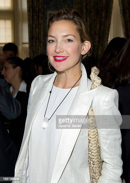 Kate Hudson poses at Goop's party to launch the summer season at Mark's Club on May 21 2013 in London England