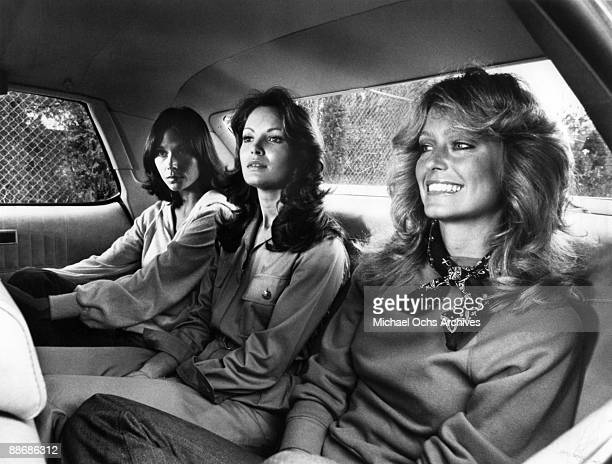 R Kate Jackson Jaclyn Smith and Farrah Fawcett ride in the back of a car while filming a scene for Charlie's Angels circa 1977 in Los Angeles...