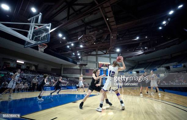 Kate Kerrigan of Bowdoin defended Madeline Eck of Amherst College during the Division III Women's Basketball Championship held at the Mayo Civic...