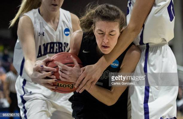 Kate Kerrigan of Bowdoin fought off Amherst College defenders during the Division III Women's Basketball Championship held at the Mayo Civic Center...
