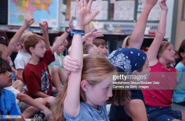 Kate Knights, a thrid-grader at Superior Elementary raises her hand during Ms. Brighton's math session in the Superior school on a recent weekday.