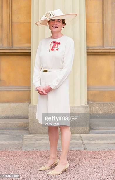 Kate Lampard holds her CBE which was awarded to her by the Prince of Wales at an investiture ceremony at Buckingham Palace on June 12 2015 in London...
