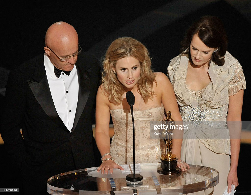 Kate Ledger (C), sister of late Heath Ledger, accepts the award for Best Supporting Actor for 'The Dark Night' with father Kim (L) and mother Sally (R) during the 81st Annual Academy Awards held at Kodak Theatre on February 22, 2009 in Los Angeles, California.