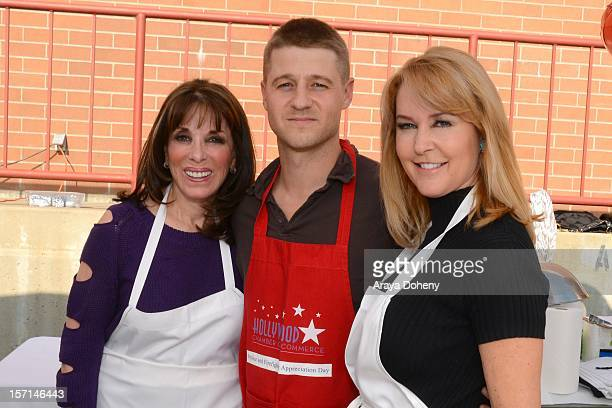 Kate Linder, Ben McKenzie and Erin Murphy volunteer at the the Hollywood Chamber of Commerce police and firefighters BBQ on November 28, 2012 in Los...