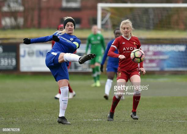 Kate Longhurst of Liverpool Ladies competes with Katie Chapman of Chelsea Ladies during the SSE Women's FA Cup Quarter Final match between Liverpool...