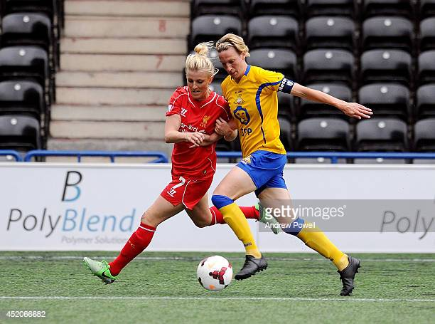 Kate Longhurst of Liverpool Ladies competes with Leandra Little of Doncaster Rovers Belles during the FA WSL Continental Cup match between Liverpool...