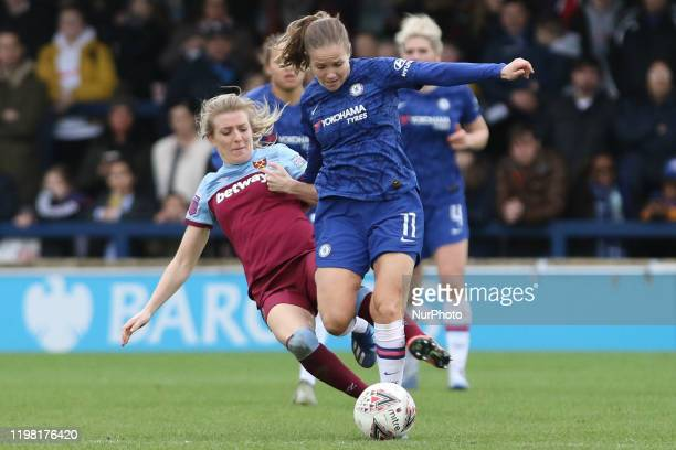 Kate Longhurst of West Ham United Women tripping Guro Reiten of Chelsea Women during the Barclays FA Women's Super League match between Chelsea and...