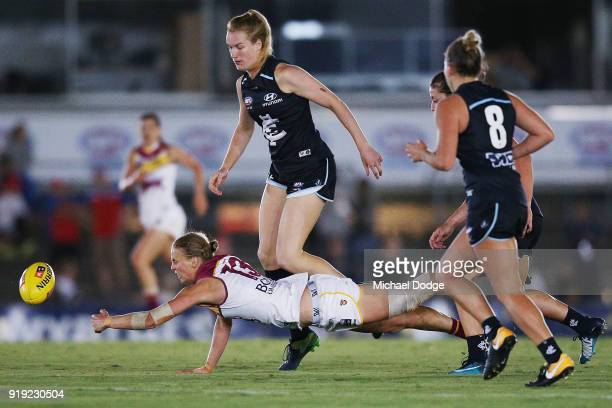 Kate Lutkins of the Lions taps the ball forward during the round three AFLW match between the Carlton Blues and the Brisbane Lions at Ikon Park on...