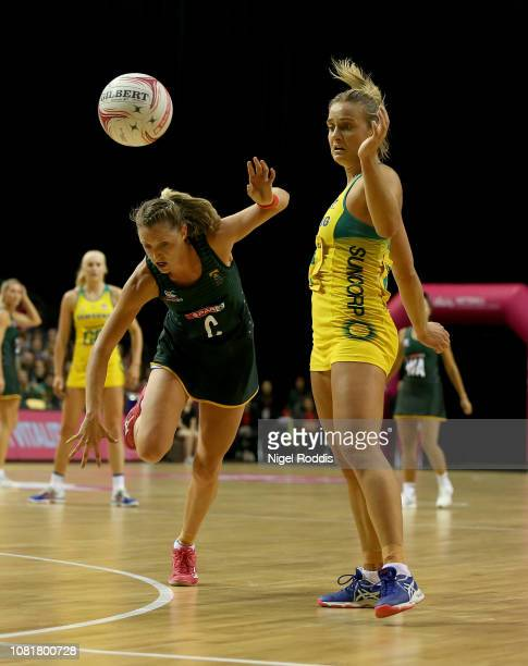 Kate Maloney of Australia in action with Erin Burger of South Africa during the Vitality Netball International Series match between South Africa and...