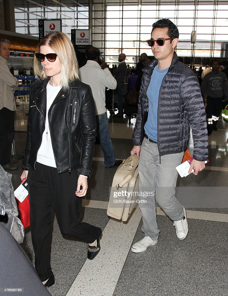 Kate Mara and Max Minghella are seen at LAX airport on March 03, 2014 in Los Angeles, California.