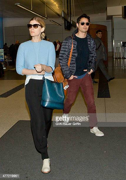 Kate Mara and Max Minghella are seen at LAX on March 07 2014 in Los Angeles California