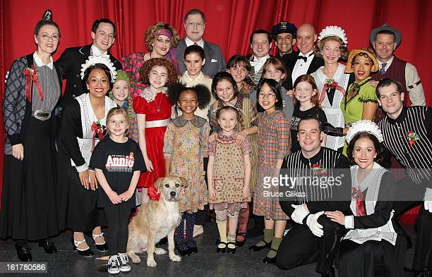 Kate Mara poses with the cast backstage at the hit musical 'Annie' on Broadway at The Palace Theater on February 15 2013 in New York City