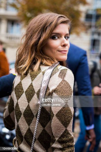 Kate Mara, wearing a diamond printed sweater, is seen after the Miu Miu show on October 2, 2018 in Paris, France.