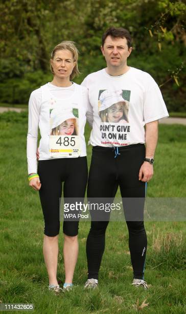 Kate McCann and Gerry McCann the parents of missing child Madeline McCann pose before the start of the 'Miles for Missing People' charity run in...