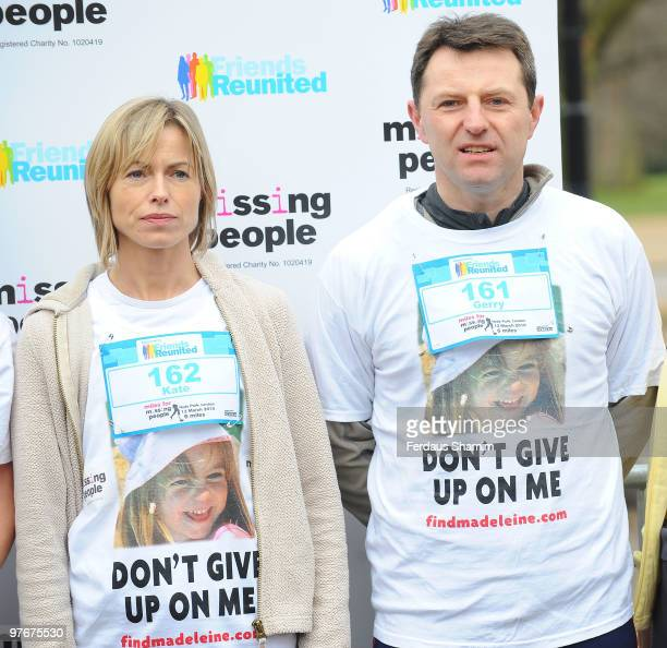 Kate McCann and Gerry McCann wearing tshirts printed with a photo of their missing daughter Madeleine attend the Miles For Missing People 10km...