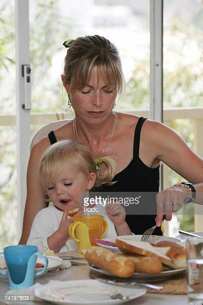 Kate McCann and her daughter Amelie have breakfast in their appartment in Praia da Luz in Portugal 19 May 2007 Madeleine McCann vanished from a...