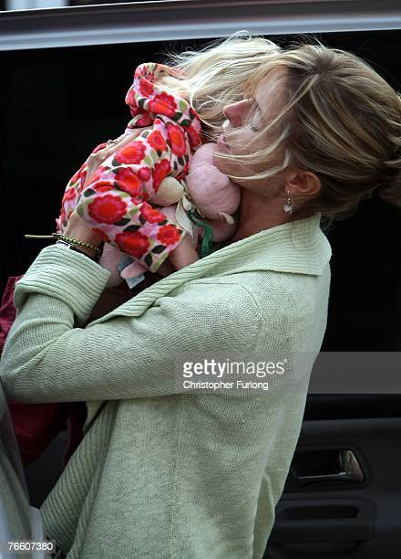 Kate McCann arrives home carrying her daughter Amelie on September 9 2007 in Rothley England The McCann family have returned from Portugal after...