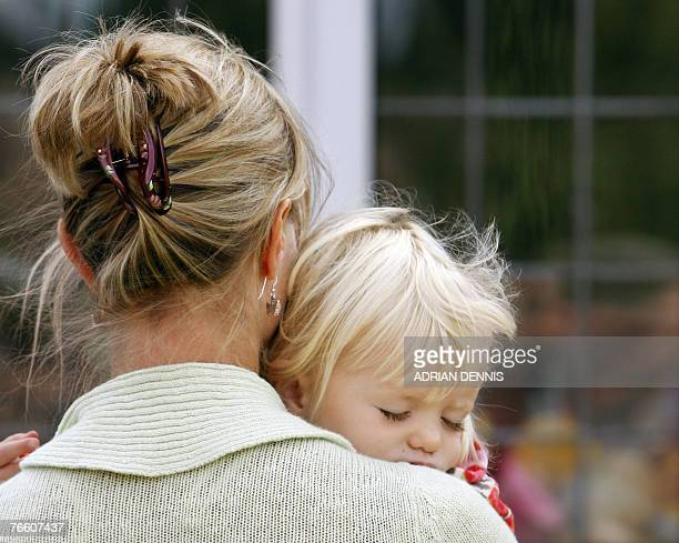 Kate McCann carries one of her twins Amelie into the house after arriving back at the family home in Rothley Leicestershire 09 September 2007 The...