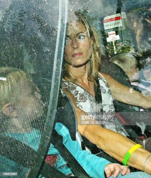 Kate McCann drives out of her home in Rothley Leicestershire in central England 12 September 2007 with her children Sean and Amelie As the pressure...