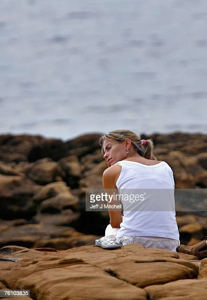 Kate McCann sits on rocks after attending a church service on August 15 2007 in Praia da Luz Portugal It has been 104 days since fouryearold...