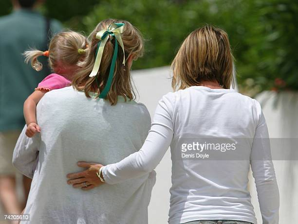 Kate McCann the mother of missing girl Madeleine carries her daughter Amelie back to their apartment on May 21 2007 in Praia da Luz Portugal Kate's...