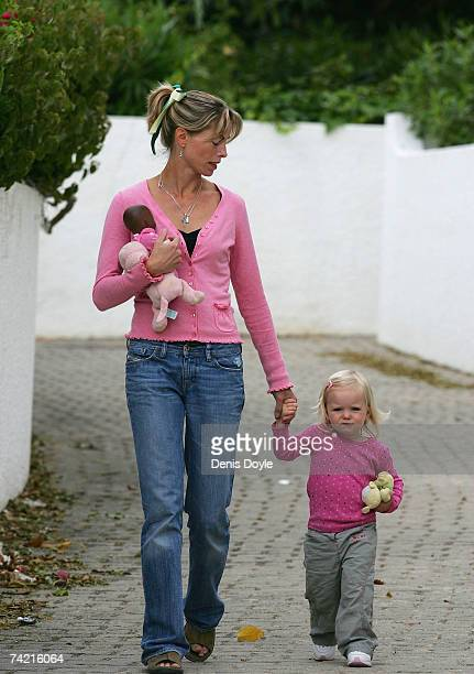 Kate McCann the mother of missing girl Madeleine holds her daughter Amelie's hand while dropping her off at the nursery at the Ocean Club holiday...