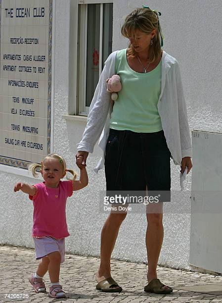 Kate McCann the mother of missing girl Madeleine walks her daughter Amelie back to their apartment on May 21 2007 in Praia da Luz Portugal Kate's...