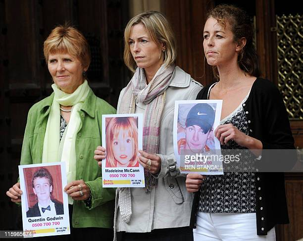 Kate McCann, the mother of missing Madeleine McCann, poses with parents of missing children Sarah Godwin and Nicki Durbin outside the Houses of...
