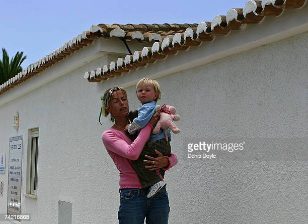 Kate McCann the mother of the missing British girl Madeleine carries her son Sean after piking him up from the local nursery at the Ocean Club...