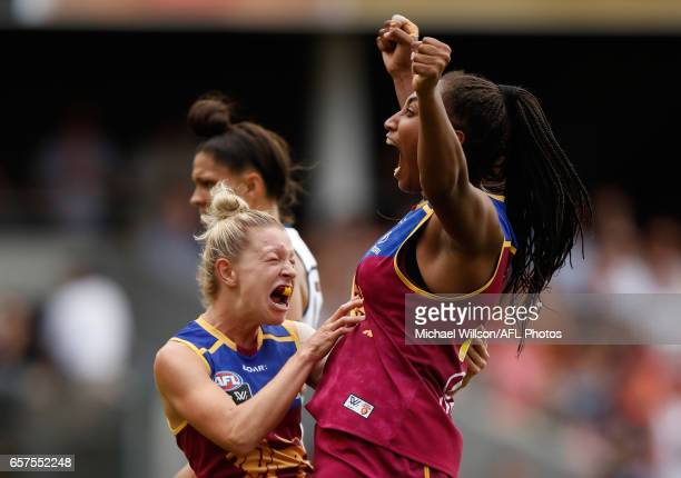 Kate McCarthy and Sabrina FrederickTraub of the Lions celebrate a goal during the 2017 AFLW Grand Final match between the Brisbane Lions and the...