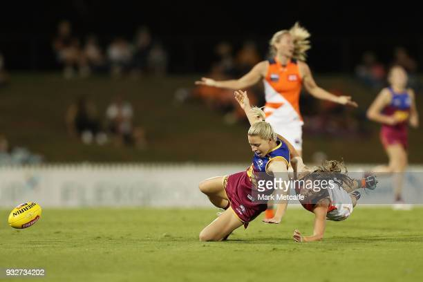 Kate McCarthy of the Lions is tackled by Alicia Eva of the Giants during the round seven AFLW match between the Greater Western Sydney Giants and the...
