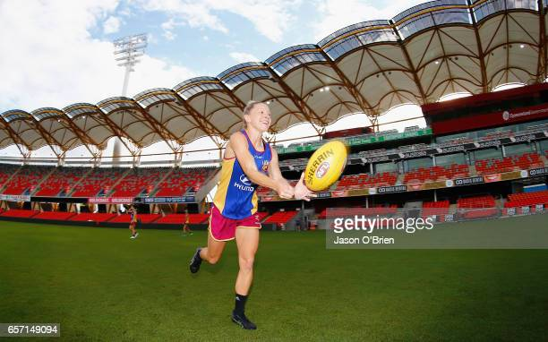 Kate McCarthy warms up at the start of training during the Brisbane Lions Women's AFL training session on March 24 2017 in Brisbane Australia
