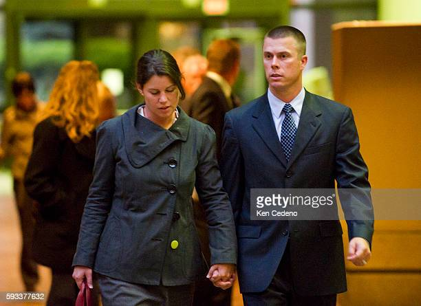 Kate McGrailMurray left and husband Hugh Murray walk toward the exit of the Montgomery County Circuit Court in Rockville MD October 27 2011 on the...