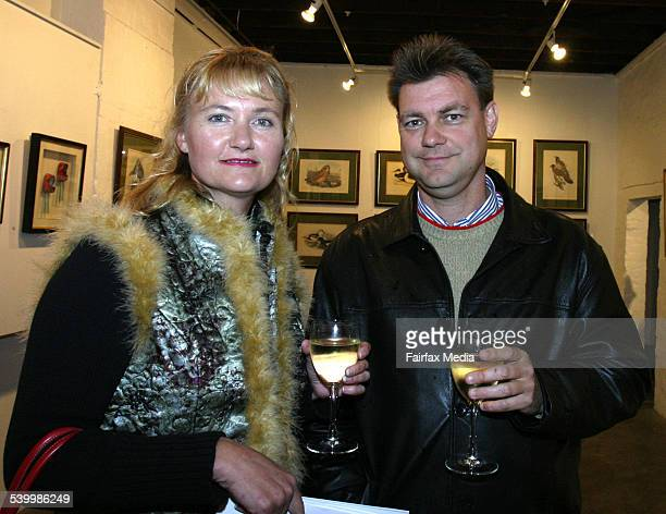 Kate McMurray and Malcolm Barnes at the Grays Online art auction Global Gallery Paddington Sydney 24 May 2006 SHD Picture by JANIE BARRETT