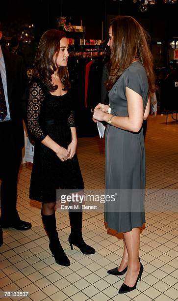 Kate Middleton and her sister Pippa attend the book launch party of 'Time To Reflect' by photographer Alistair Morrison at Bluebird on November 28...