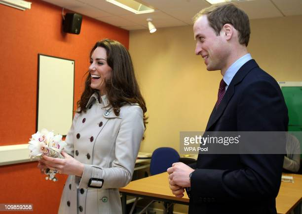 Kate Middleton and Prince William share a joke at Greenmount College in Co Antrim during their one day visit on March 08 2011 in County Antrim...