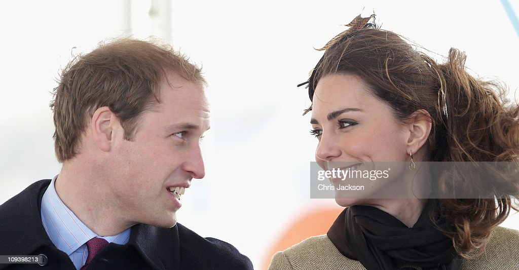 Kate Middleton and Prince William smile as they visit Trearddur Bay Lifeboat Station at Anglesey on February 24, 2011 in Trearddur, Wales. The newly engaged couple named the Trearddur Bay Lifeboat Station's new Atlantic 85 inshore lifeboat the 'Hereford Endeavour.' The vessel was launched during the naming ceremony and the crew demonstrate some of her rescue capabilities. The country is gearing up for the much anticipated wedding of the couple scheduled to take place on April 29, 2011 at Westminster Abbey in London.