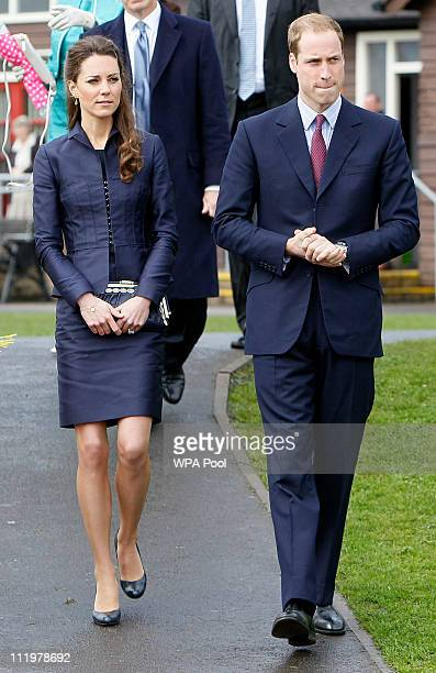 Kate Middleton and Prince William walk to meet youths from a local soccer club at Witton County Park during a visit Darwen Aldridge Community Academy...